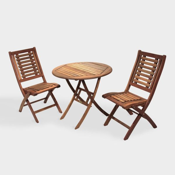 A wooden circle top folding table and 2 chairs