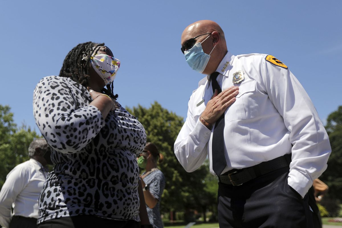 Darlene McDonald, left, and Salt Lake City Police Chief Mike Brown talk after a press conference to announce the Salt Lake City Commission on Racial in Policing at the International Peace Gardens in Salt Lake City on Thursday, June 25, 2020. McDonald will serve on the commission.