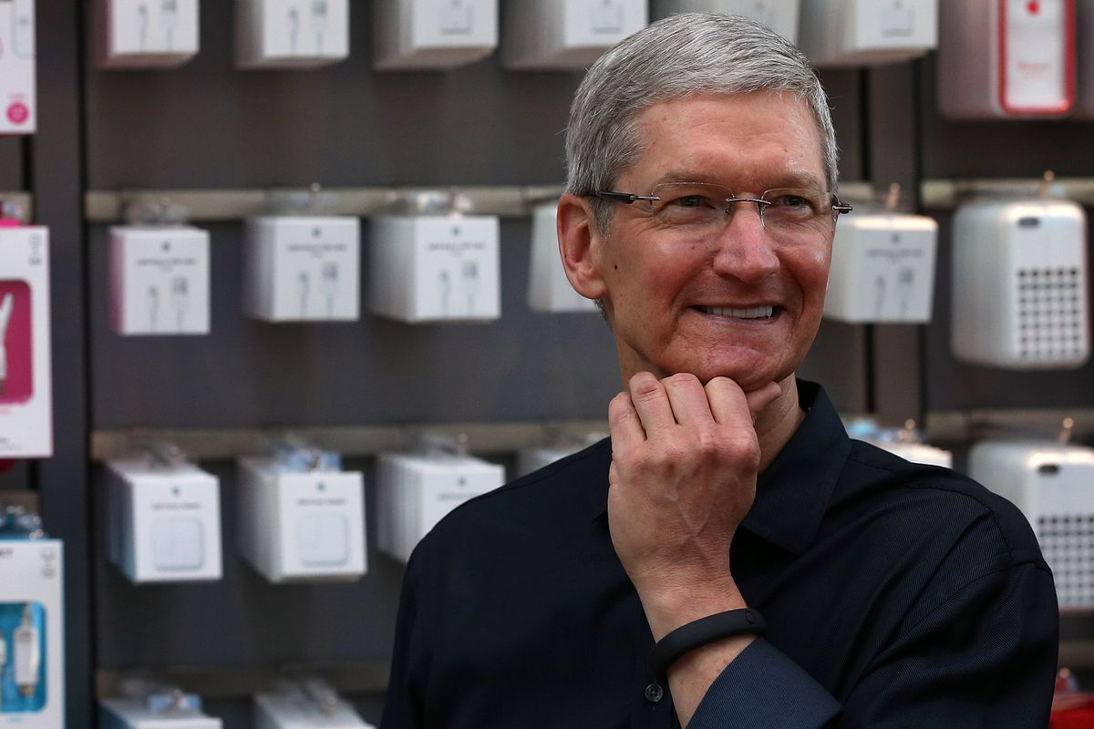 Apple CEO Tim Cook, working on his pose
