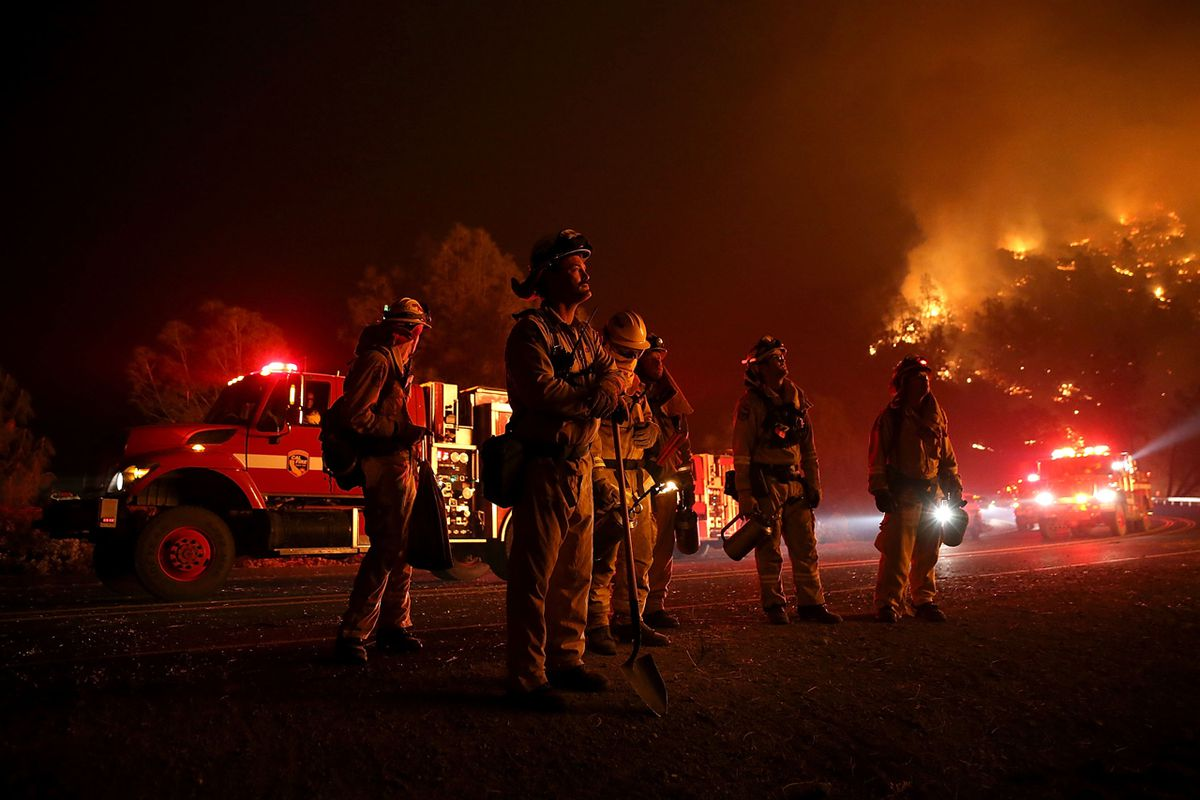 Firefighters monitor a backfire ahead of the Rocky Fire last month near Clearlake, Calif.