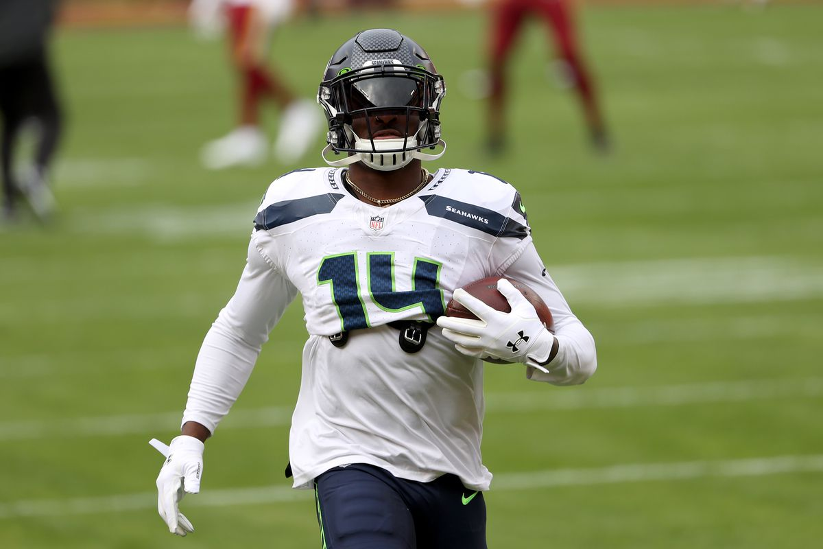 Wide receiver DK Metcalf #14 of the Seattle Seahawks warms up before the start of their game against the Washington Football Team at FedExField on December 20, 2020 in Landover, Maryland.