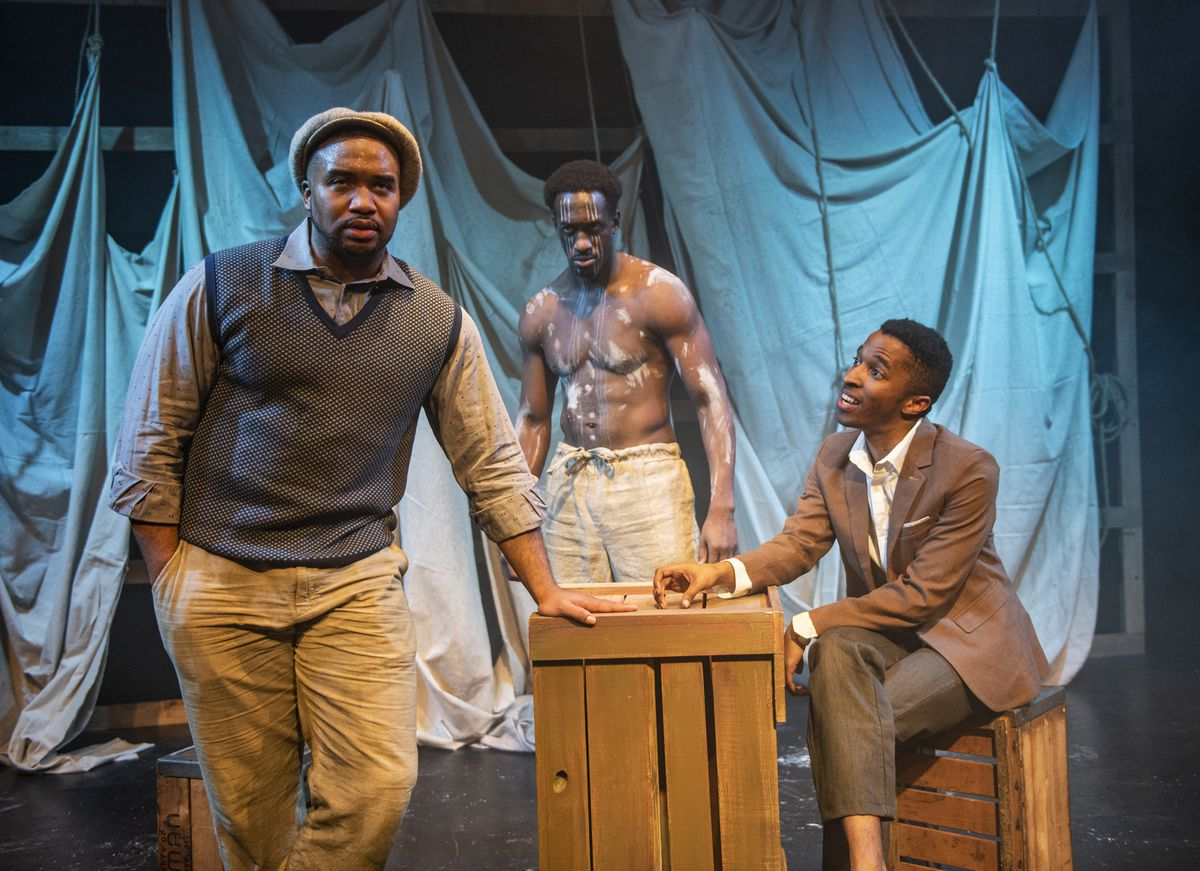 """Lewon Johns (from left), David Goodloe and Michael Turrentine star in Griffin Theatre Company's Midwest premiere of """"Mlima's Tale."""""""