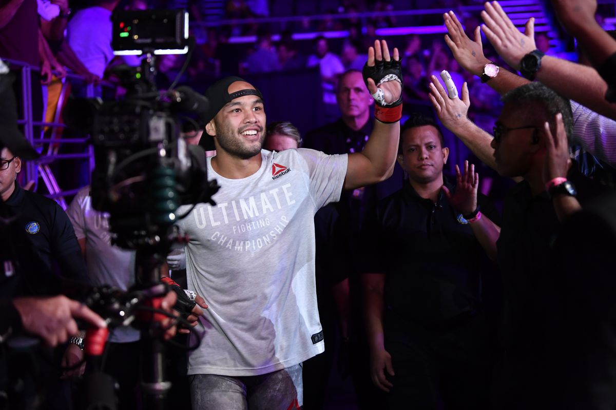Frank Camacho of Guam walks to the Octagon prior to his lightweight bout against Beneil Dariush during the UFC Fight Night event at Singapore Indoor Stadium on October 26, 2019 in Singapore.