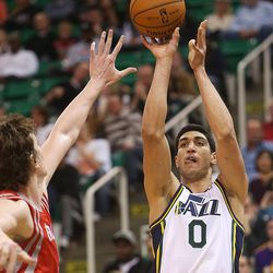 Utah Jazz's center Enes Kanter (0) shoots over the defense of Houston's Omer Asik as the Jazz and the Rockets play Saturday, Nov. 2, 2013 in EnergySolutions arena.