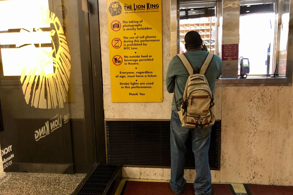 """Bronx resident Cornelius Mohabir, 30, returns a pair of tickets for a now-canceled performance of """"The Lion King"""" at the shuttered Minskoff Theatre."""
