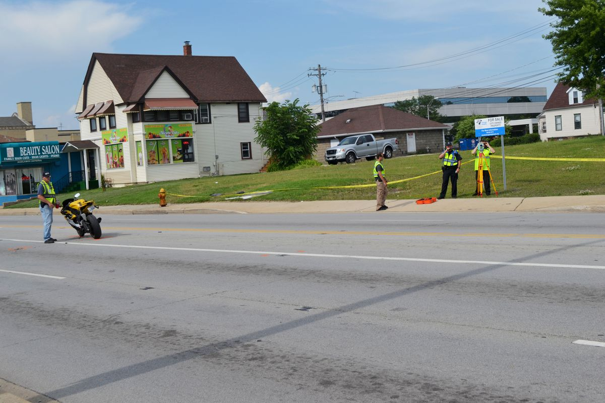 Police investigate a crash between a motorcycle and a car July 2, 2019, near 16th Street and Chicago Road in Chicago Heights.
