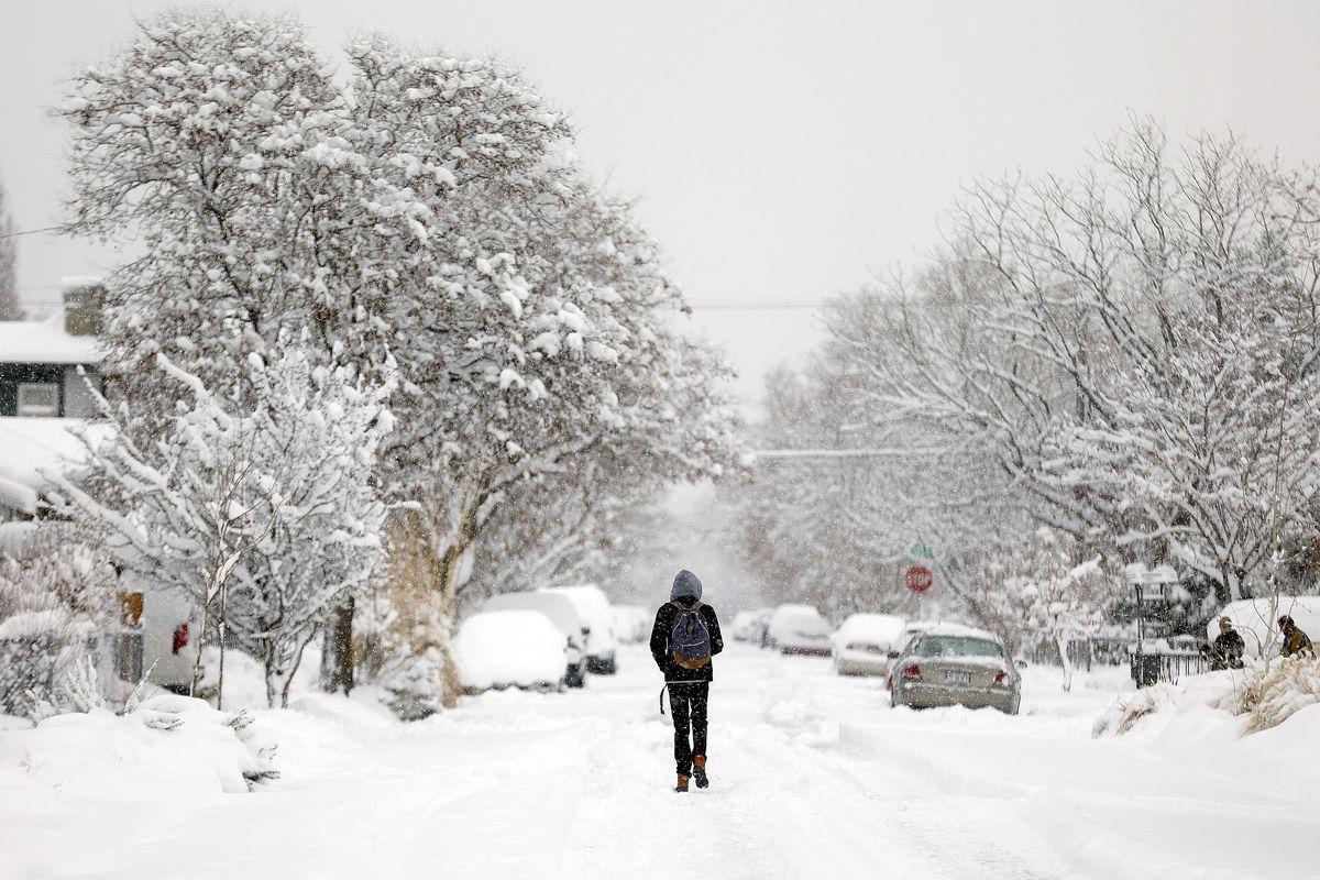 A man walks after a snowstorm in Salt Lake City.