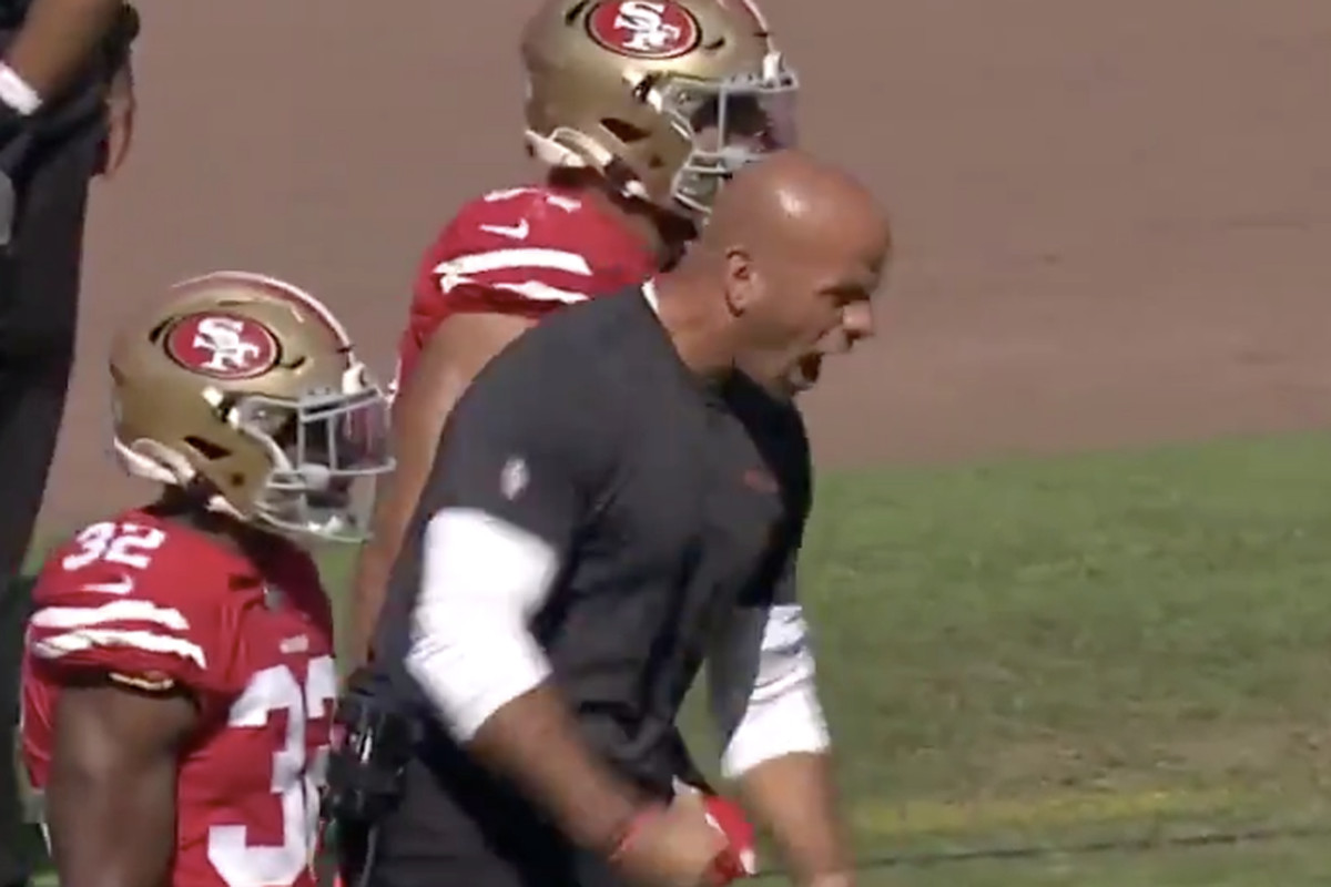 49ers defensive coordinator Robert Saleh is fired up after a goal line stop against the Rams.