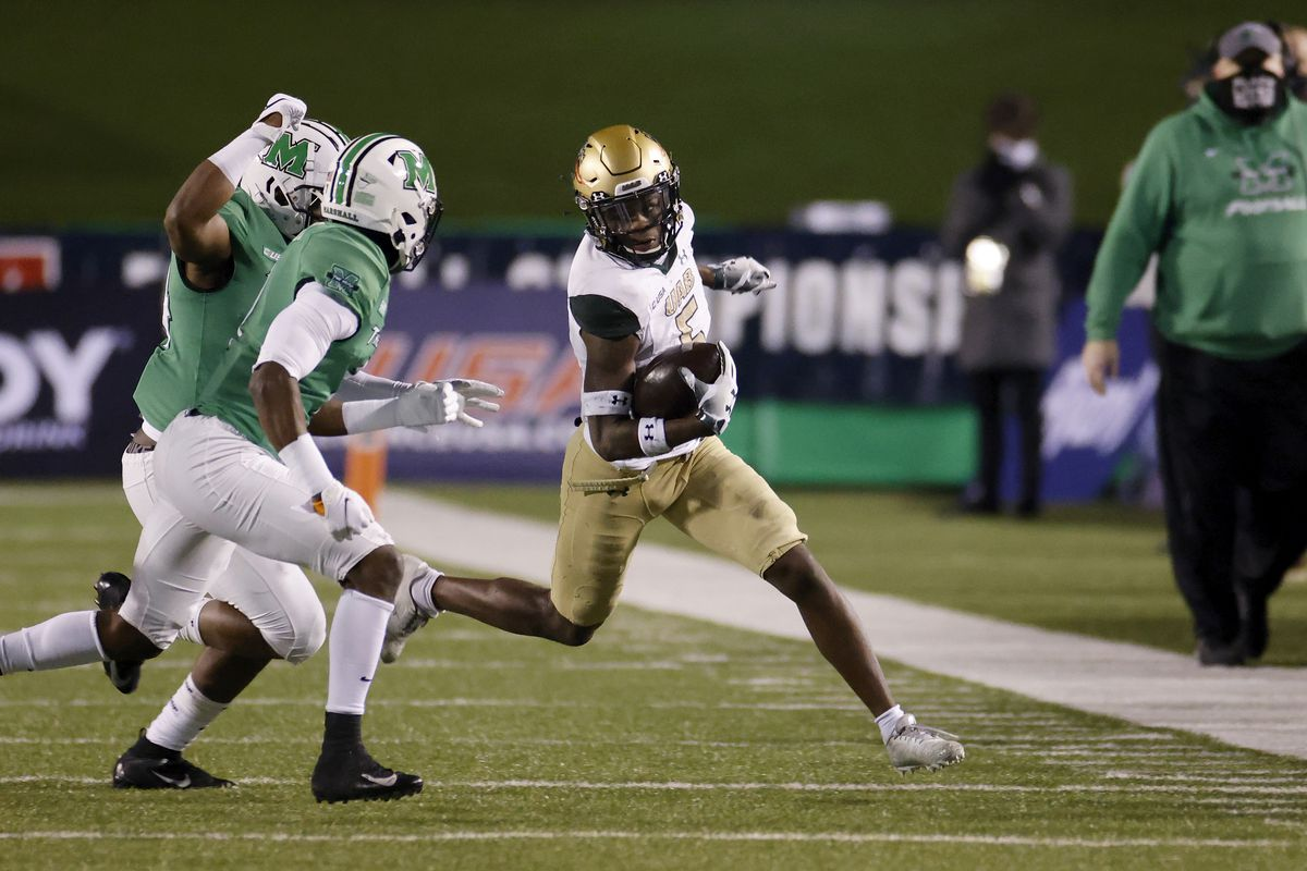 Myron Mitchell of the UAB Blazers runs with the ball against the Marshall Thundering Herd in the first half of the Conference USA Championship at Joan C. Edwards Stadium on December 18, 2020 in Huntington, West Virginia.