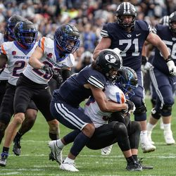 Boise State safety Alexander Teubner, right, gets tackled by BYU wide receiver Keanu Hill after Teubner recovered a BYU fumble during an NCAA college football game at LaVell Edwards Stadium in Provo on Saturday, Oct. 9, 2021.
