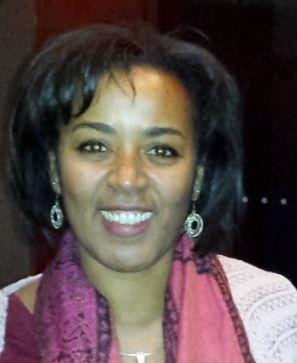 Headshot of Tracy Garrison-Feinberg smiling.