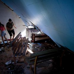 A woman and girl walk inside an earthquake damaged church in Bellavista, Costa Rica, Thursday, Sept. 6, 2012. A powerful, magnitude-7.6 earthquake shook Costa Rica and a wide swath of Central America on Wednesday.