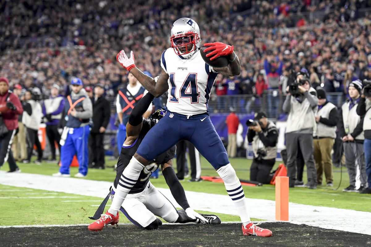 New England Patriots wide receiver Mohamed Sanu runs the ball in for a touchdown after a catch during the second quarter against the Baltimore Ravens at M&T Bank Stadium.