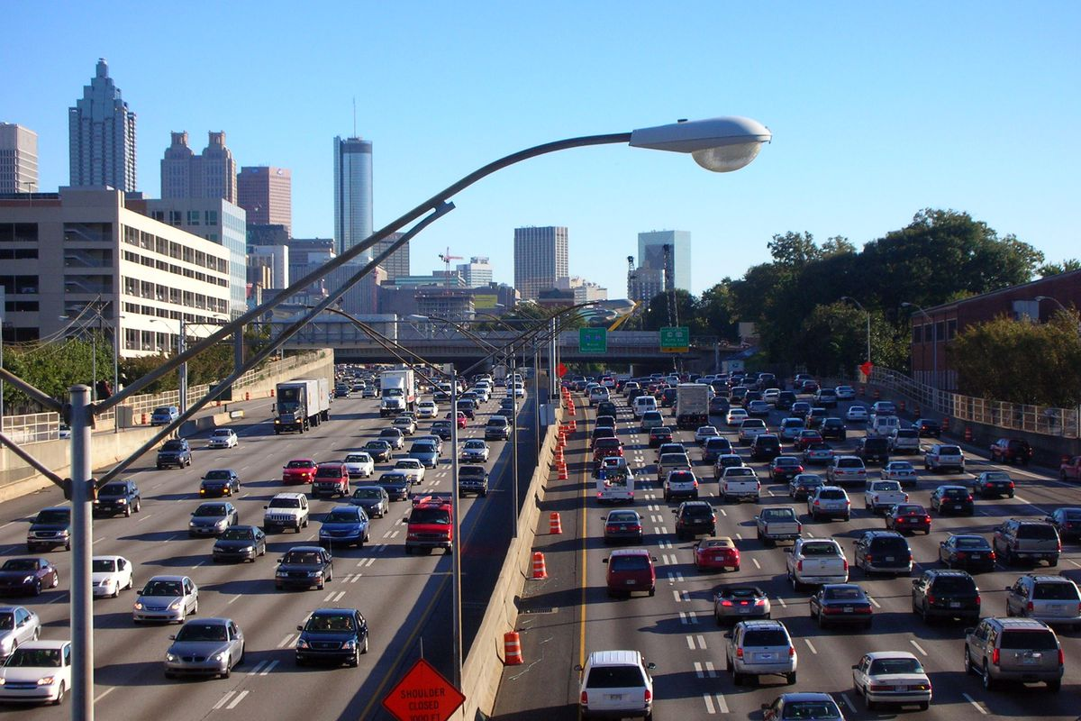 Cars sit in traffic heading both directions on the Downtown Connector.