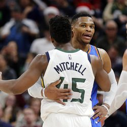 Utah Jazz guard Donovan Mitchell is greeted by Oklahoma City Thunder guard Russell Westbrook following NBA basketball in Salt Lake City on Saturday, Dec. 23, 2017.