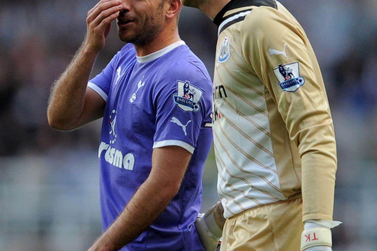 Rafael van der Vaart of Tottenham Hotspur caught in the act trying to recruit Tim Krul