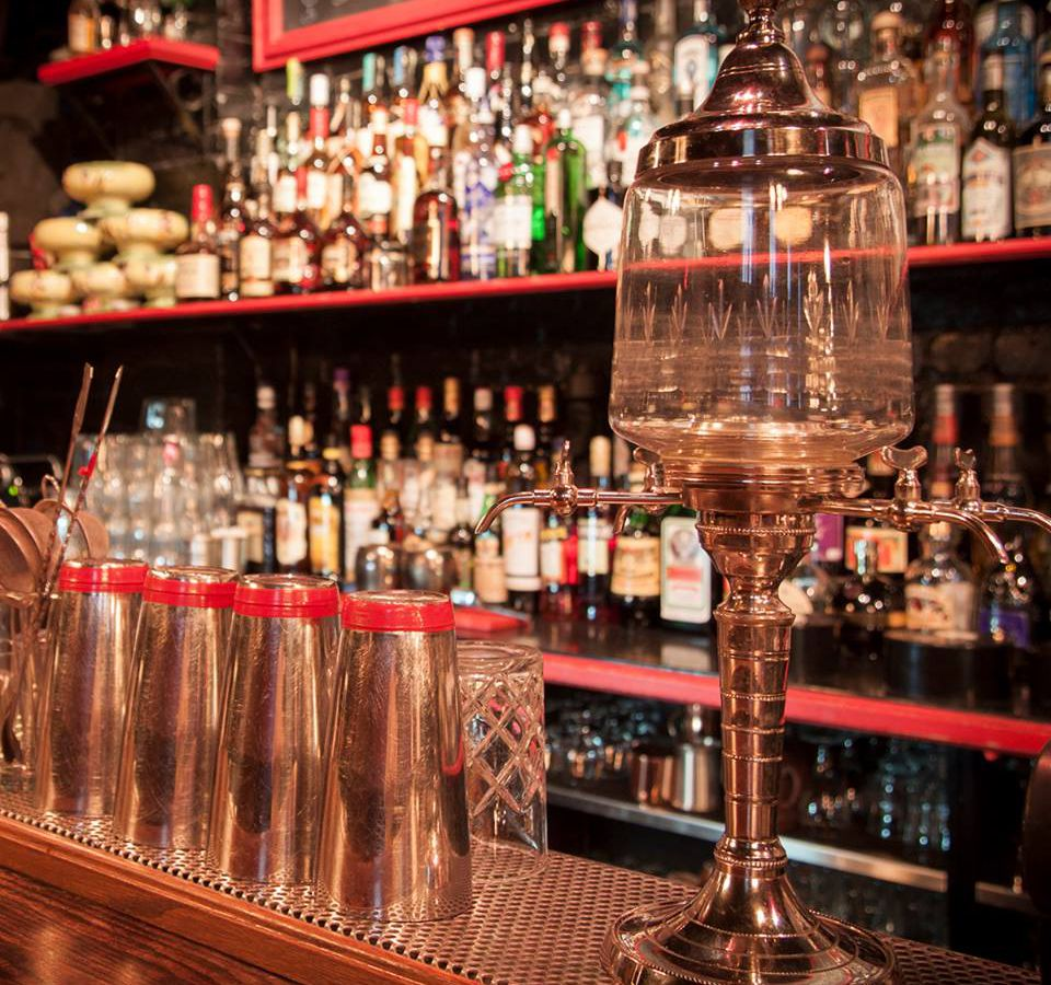 A wall full of liquor bottles behind the bar at Le Lab.
