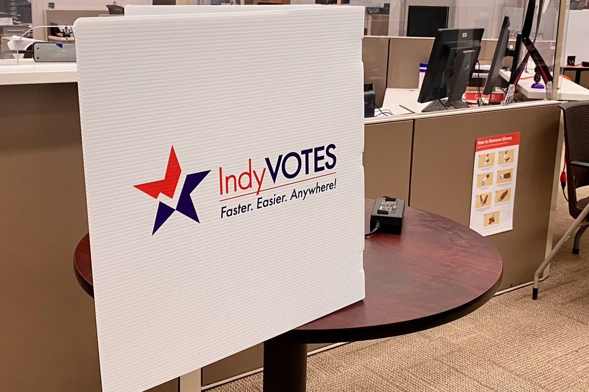 """Voting privacy shield with """"IndyVotes"""" printed on it."""
