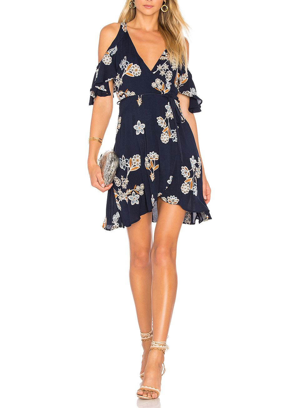 A model wearing a casual floral dress