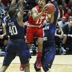 Utah Utes guard Brandon Taylor (11) jumps toward the hoop as Utah and BYU play in the Huntsman Center in Salt Lake City Wednesday, Dec. 2, 2015. Utah won 83-75.
