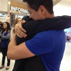 Antonio Lopez hugs his nephew, Noel Lopez, upon Noel's return from his mission to Uruguay.