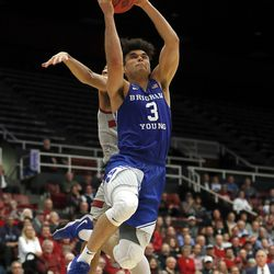 20180315 BYU guard Elijah Bryant (3) drive to the basket against Stanford guard Dorian Pickens during the second half of an NCAA college basketball game in the first round of the NIT, Wednesday, March 14, 2018, in Stanford, Calif. (AP Photo/Tony Avelar) Tony Avelar Elijah Bryant, Dorian Pickens FR155217 AP