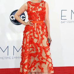 FILE - This Sept. 23, 2012 file photo shows actress Ginnifer Goodwin arriving at the 64th Primetime Emmy Awards at the Nokia Theatre in Los Angeles.  Sunday's Emmy Awards opened the first big fashion red-carpet of the season _ and it was a long runway: a parade of rainbow-bright gowns, skyscraper heels, glittering clutches that only hold a lipstick, along with millions of dollars in jewels.