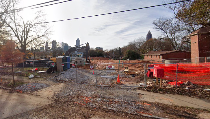 A construction site with skyscrapers in the background.