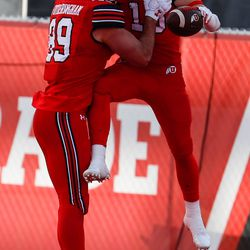 Utah Utes tight end Cole Fotheringham (89) celebrates with Utah Utes wide receiver Britain Covey (18) for a team touch down during an NCAA football game at Rice-Eccles Stadium in Salt Lake City on Saturday, Dec. 19, 2020.