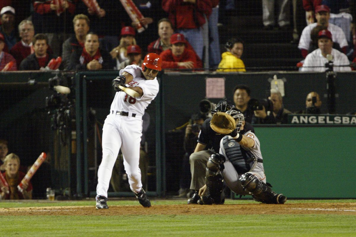 Garret Anderson hits a three-run double in Game 7 of the 2002 World Series. (<em>Photo: Jeff Gross   Getty Images Sport</em>)