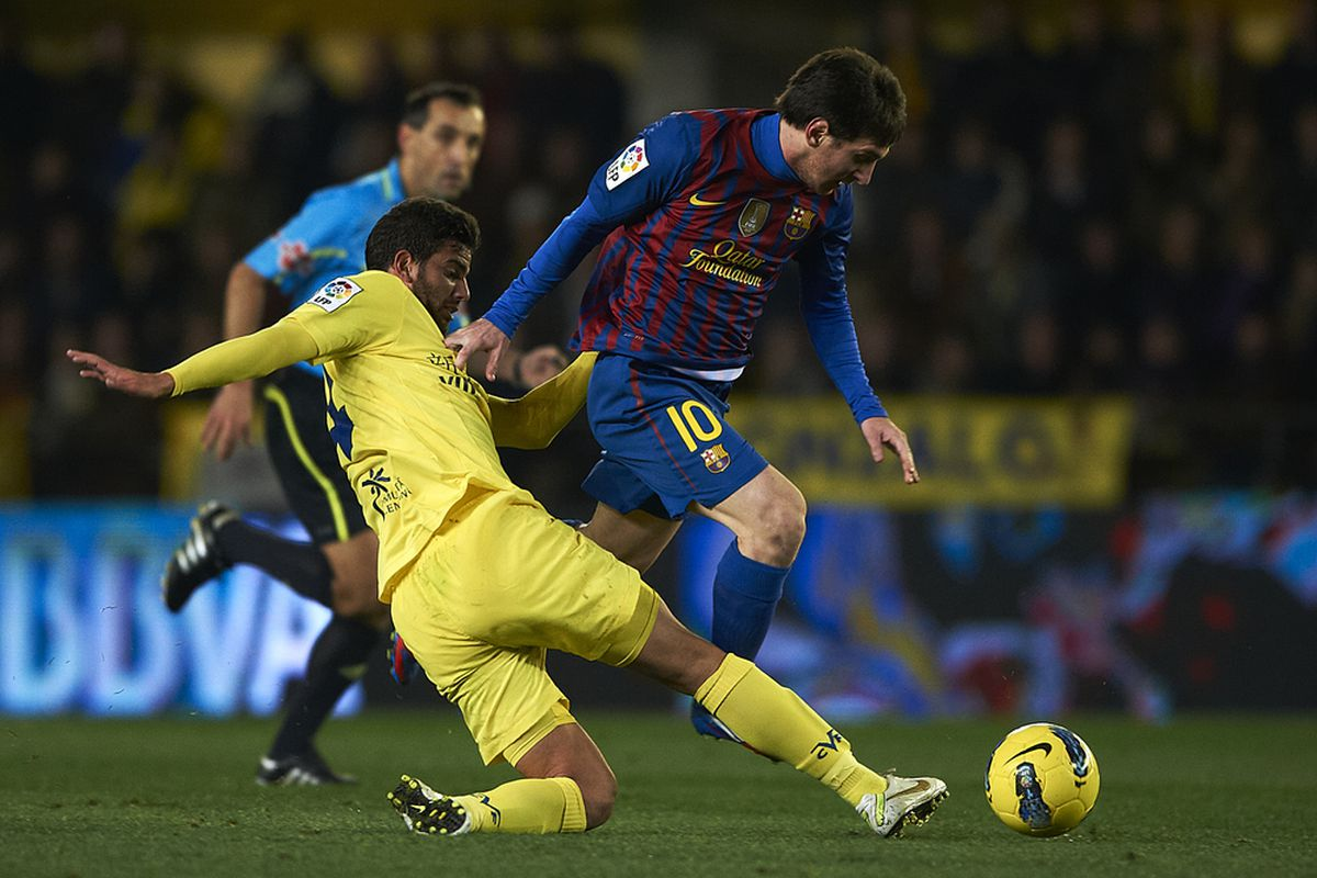We can expect a lot of this on Sunday--Mateo Musacchio competiting with Lionel Messi