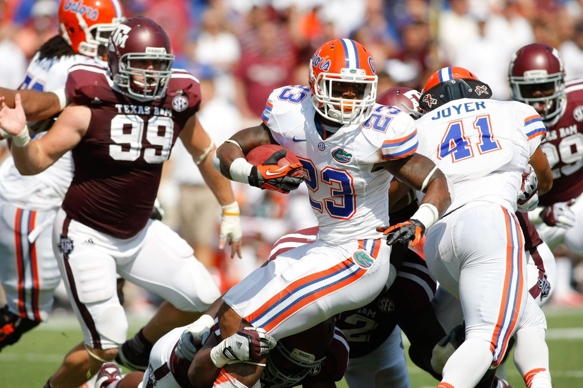 Sep 8, 2012; College Station, TX, USA; Florida Gators running back Mike Gillislee (23) runs the ball against the Texas A&M Aggies in the second quarter at Kyle Field. Mandatory Credit: Brett Davis-US PRESSWIRE