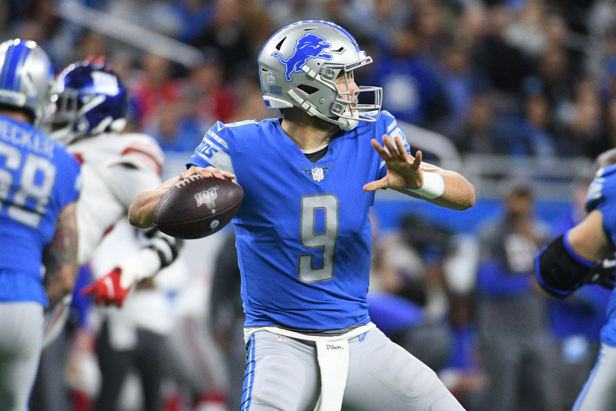 Detroit Lions quarterback Matthew Stafford drops back to pass during the game against the New York Giants at Ford Field.