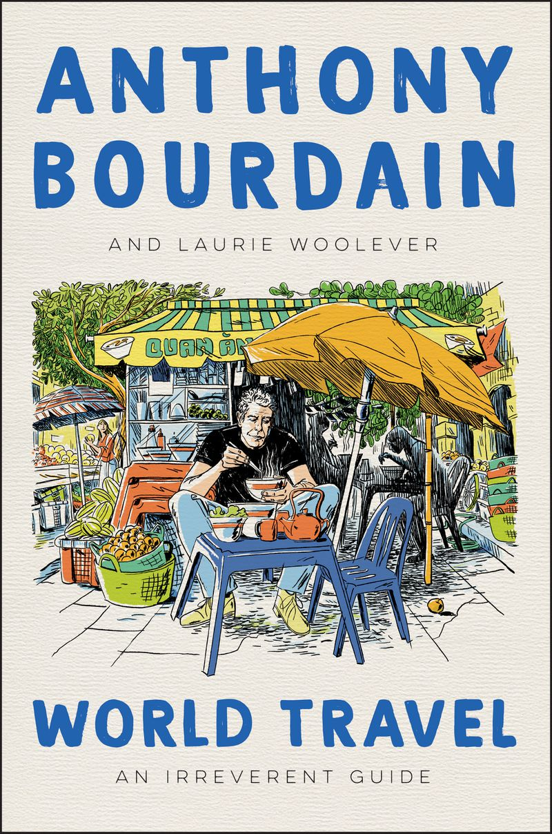 The cover of World Travel depicts Anthony Bourdain eating a bowl of food outside in Vietnam