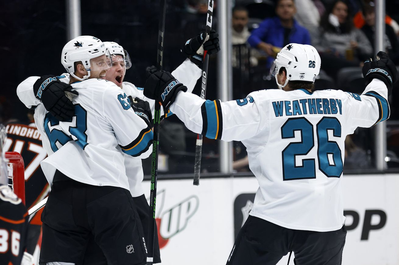 Jasper Weatherby #26 congratulates Jeffrey Viel #63 of the San Jose Sharks after his goal during the second period of a game against the Anaheim Ducks at Honda Center on September 30, 2021 in Anaheim, California.
