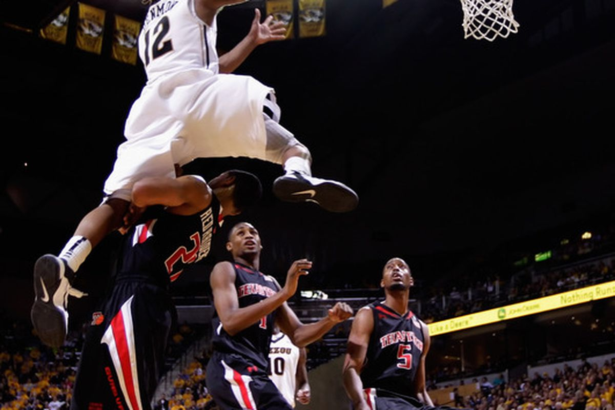 COLUMBIA MO - FEBRUARY 15:  Marcus Denmon #12 of the Missouri Tigers leaps over Texas Tech Red Raiders defenders on his way toward scoring during the game on February 15 2011 at Mizzou Arena in Columbia Missouri.  (Photo by Jamie Squire/Getty Images)