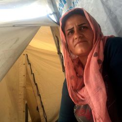 Rouya Addin, 30, lives with her four children, all under the age of 8, in a one-room tent in the Diavota refugee camp in northern Greece. She's among thousands of refugees who were stranded apart from their families when European countries closed their borders in early 2016. Addin hopes to reunite with her husband, Utep, in Germany.