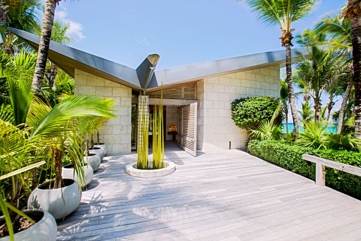 A modern residence int he bahamas with a wood deck and contemporary feel at the entrace