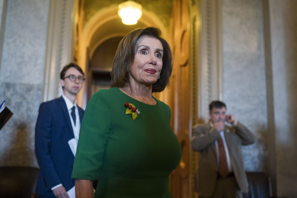 Speaker Nancy Pelosi makes her way past the Senate chamber before an event with congressional democrats to call for protections for those with pre-existing conditions on the day oral arguments were heard in attempt invalidate the Affordable Care Act on Tu