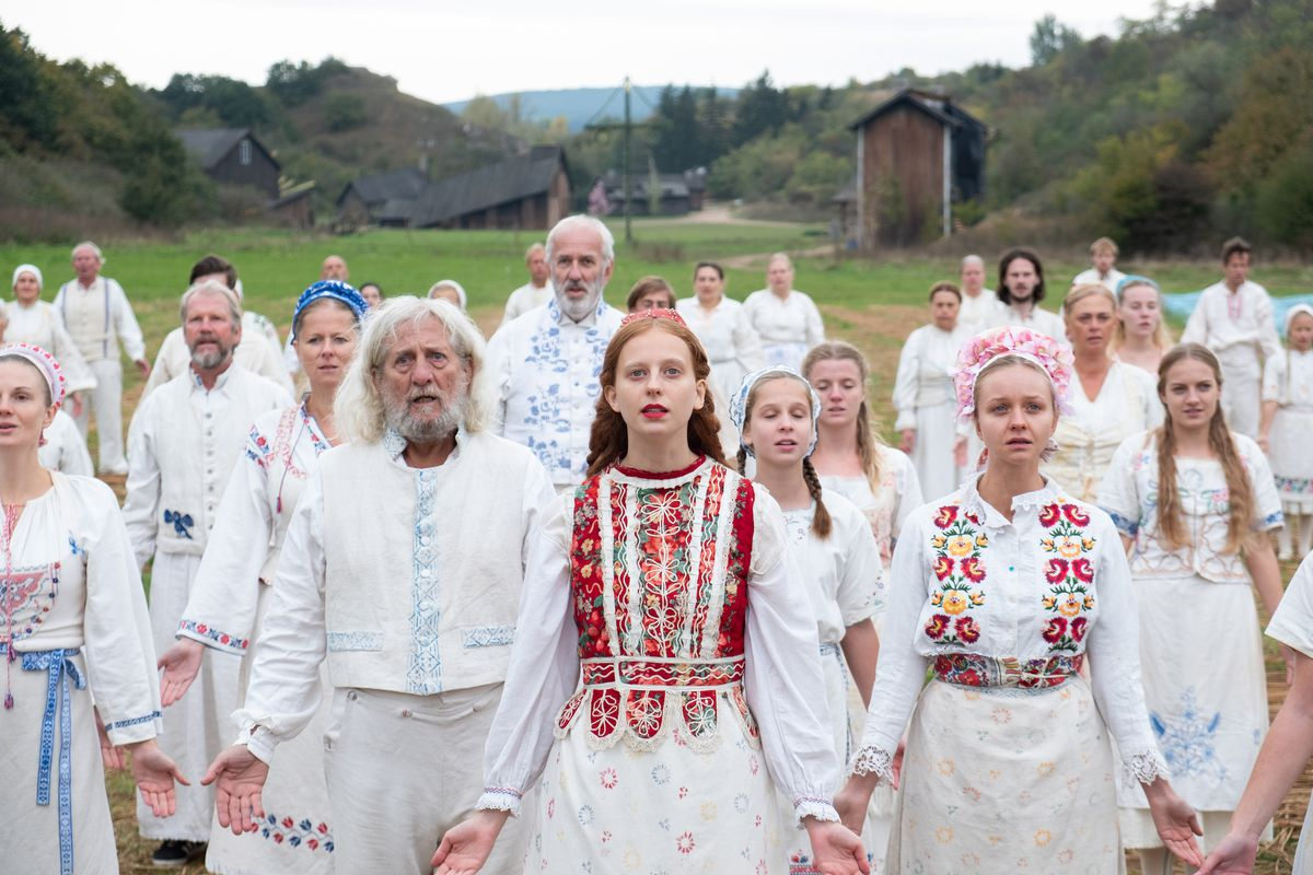 a group of swedish cultists sing a song to the mayday pole