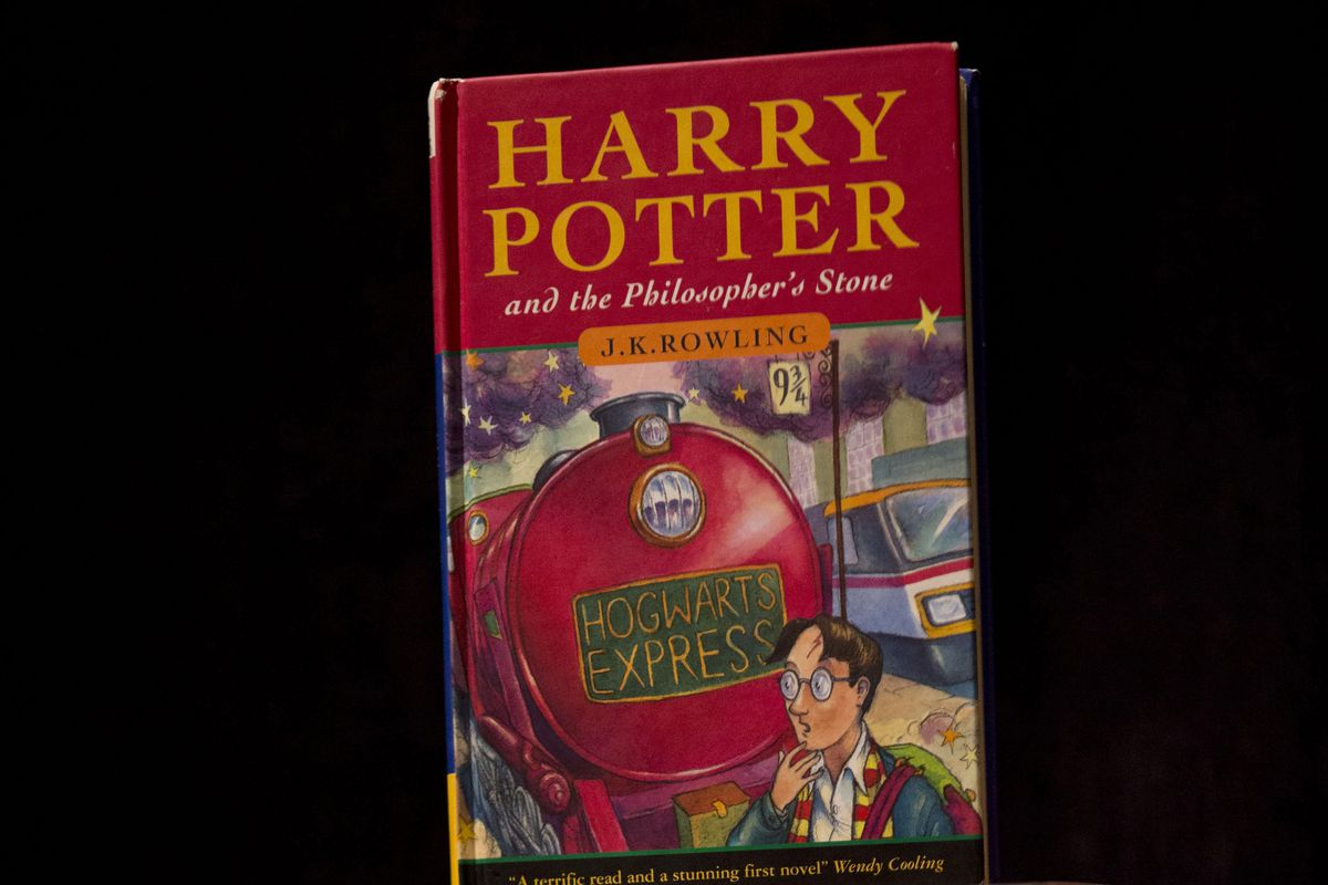 """This file photo shows a first edition copy of the first Harry Potter book """"Harry Potter and the Philosopher's Stone,"""" in 2013."""
