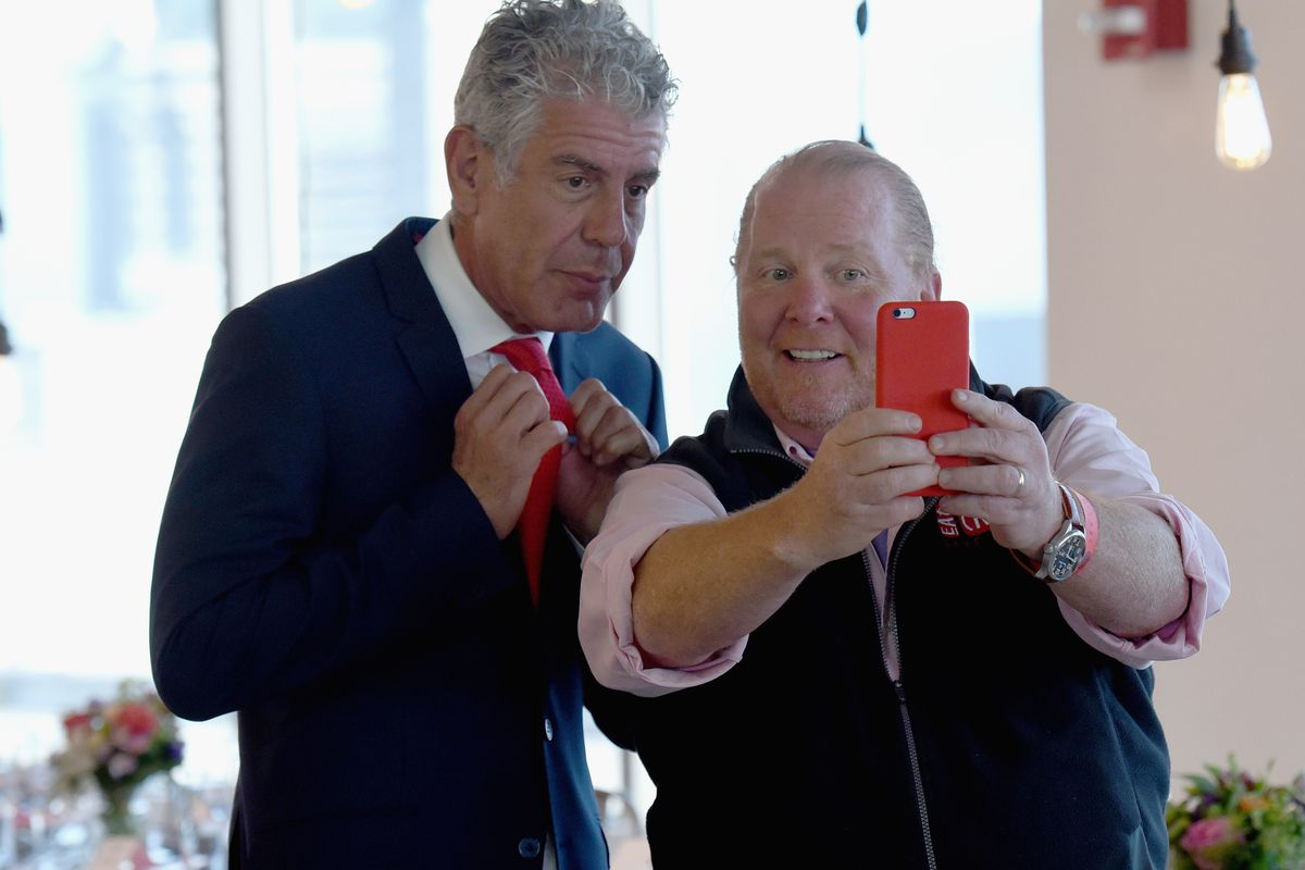 Anthony Bourdain and Mario Batali taking a selfie at a [RED] event in NYC on June 6.