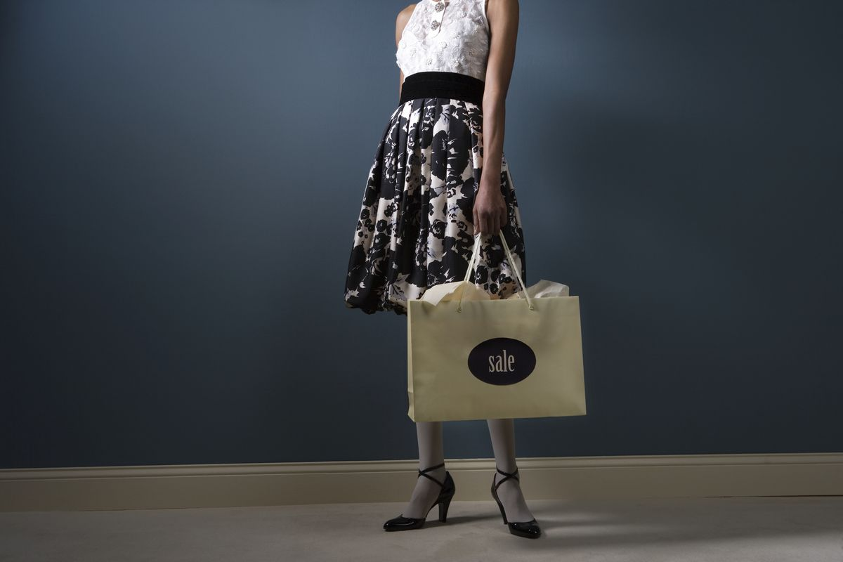 "Woman with ""sale"" bag"