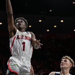 Arizona's Devonaire Doutrive (1) lays in the ball with a soft touch past Georgia Southern's Calvin Wishart (10) during the Arizona-Georgia Southern game in McKale Center on November 29 in Tucson, Ariz.