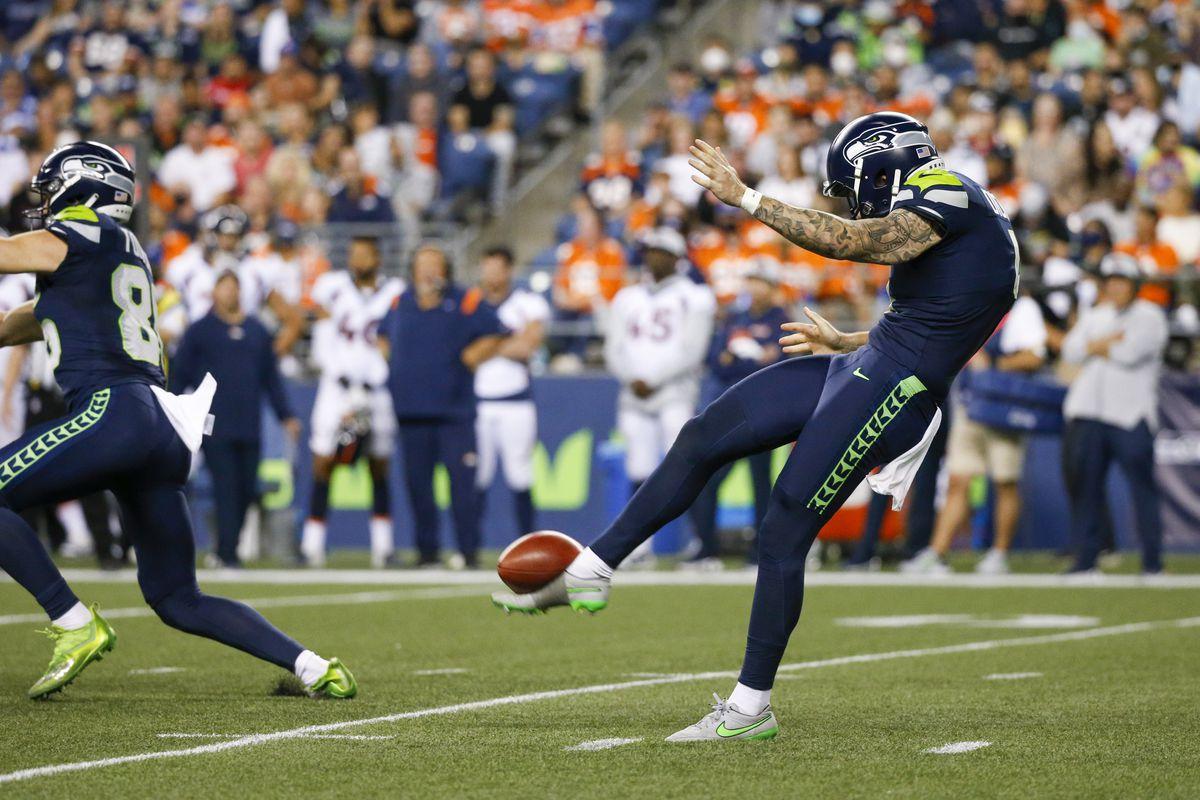 Seattle Seahawks punter Michael Dickson (4) punts against the Denver Broncos during the fourth quarter at Lumen Field.