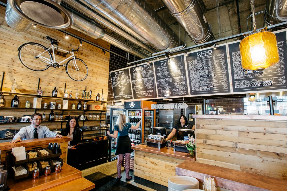 A bicycle hangs on the wood-paneled wall at Jolly Pumpkin next to the line for placing orders.