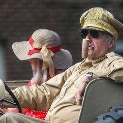 A veteran drives an old army vehicle during the Grand Parade in Provo on Monday, July 5, 2021.