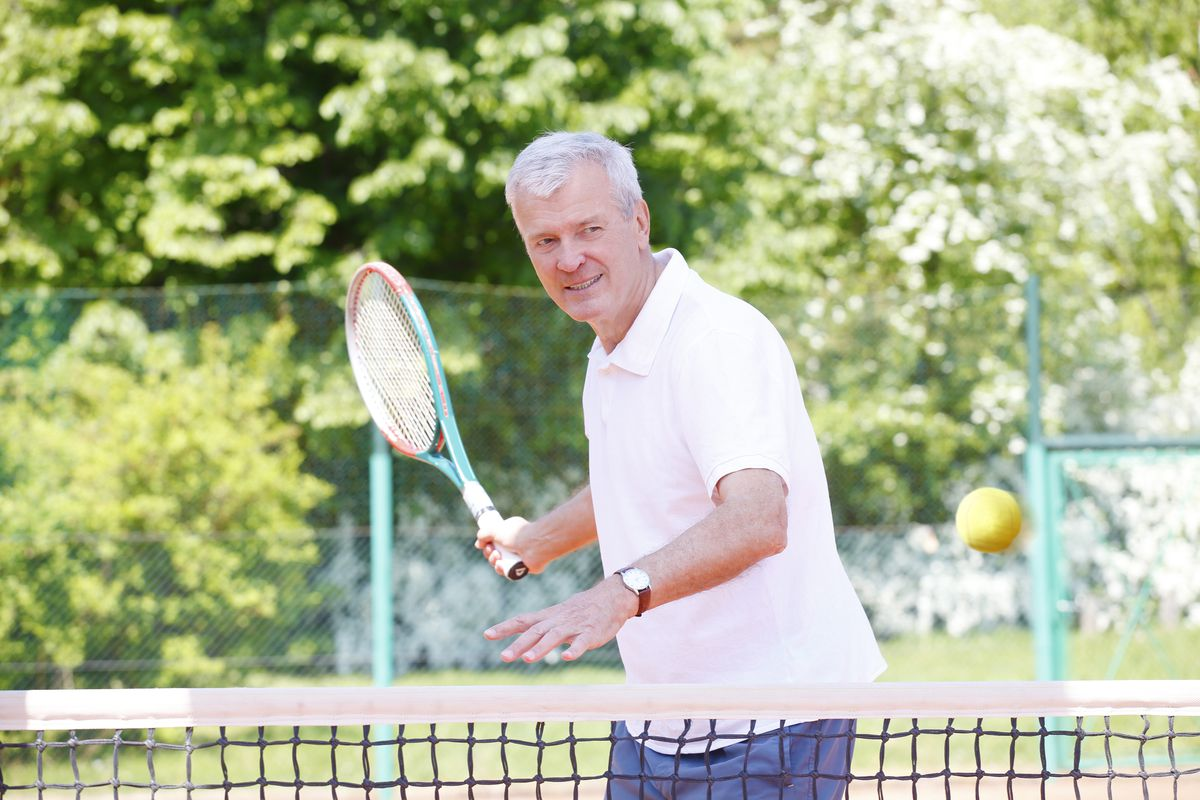 Tennis is a great sport to consider even as you age, as it challenges your mobility as well as your strength. | stock.adobe.com