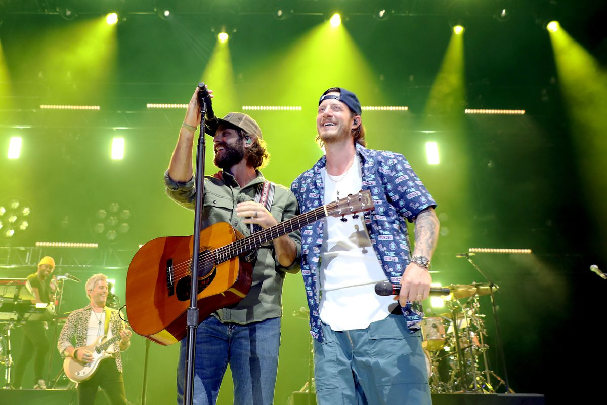 Thomas Rhett and Tyler Hubbard of Florida Georgia Line perform onstage for Feeding Nashville's live benefit concert at FirstBank Amphitheater on August 03, 2021 in Franklin, Tennessee.