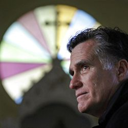 In this Thursday Dec. 22, 2011 file photo, Republican presidential candidate, former Mass. Gov. Mitt Romney, visits St. Paul's Lutheran Church while campaigning in Berlin, N.H.